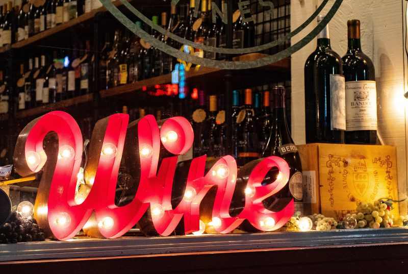 wine bottles and sign